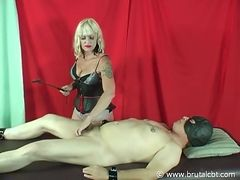 Mistress punishing cock and balls with clothespins and crop