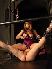 Mistress in purple fetish lingerie sits on slave's face and fucks him with a strapon cock